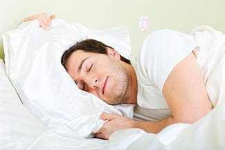 Can Chiropractic Adjustments Help Me Sleep Better? - Man Sound Asleep